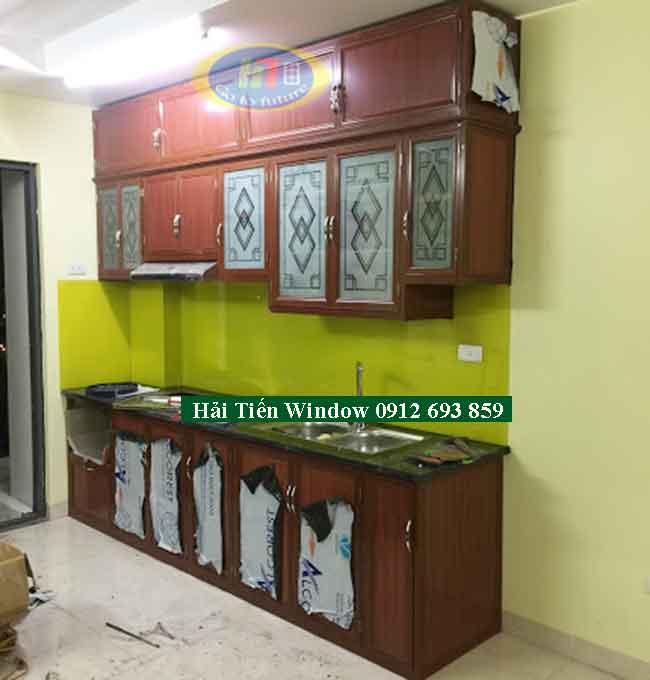 Tủ nhôm giả gỗ đẹp và kính ốp màu xanh lá